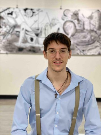 """Rafael Orti Garcia stands in front of his piece entitled """"Overwhelmed"""" Photo credit: Hana Beaty"""