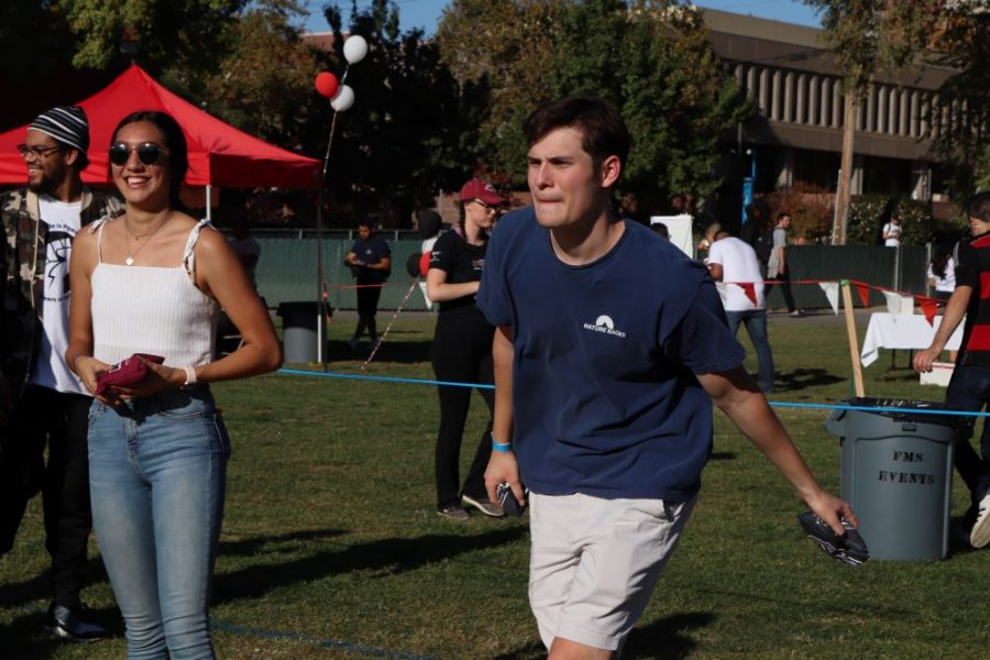 A player focuses on his target as he winds up for a toss. Photo credit: Mary Vogel