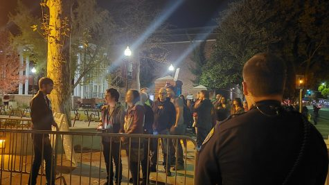 An officer watching the crowd as they get allowed into the event. Photo credit: Julian Mendoza