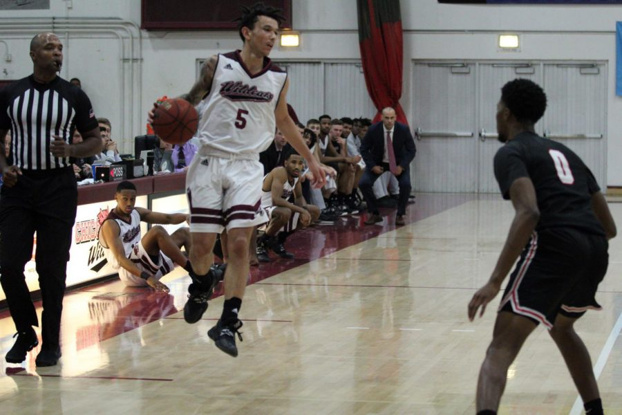 Isaiah+Brooks+brings+the+ball+up+the+floor+against+Stanislaus+State.+Photo+credit%3A+Wesley+Harris