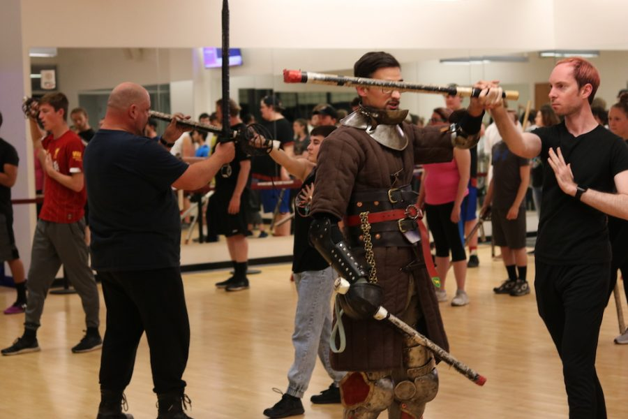 Sir Bjorn (left) and squire Alvic (right) are instructing how to swing a sword and always aim for the head if it's open. Photo credit: Jacob Collier