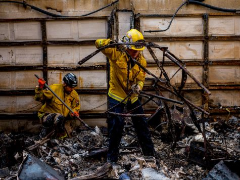 Firefighters rummaging through debris in the aftermath of the Camp Fire in Paradise, California.  Photo by Zackary Canepari (Courtesy of Netflix)