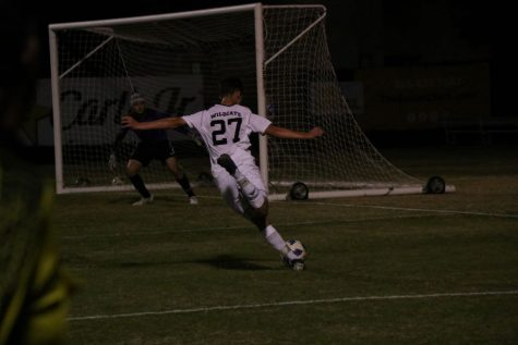 Alex Fluitt in the middle of a shot attempt. Photo credit: Mary Vogel