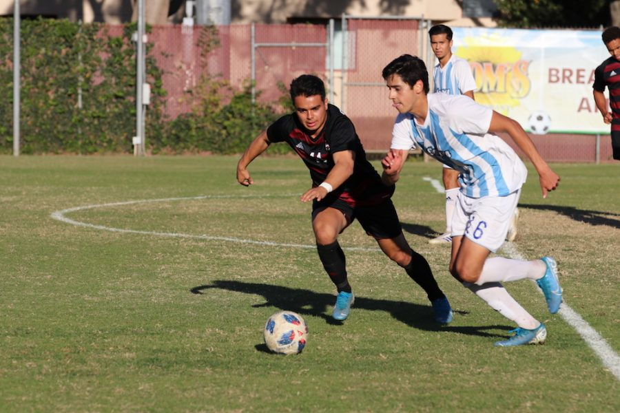 Chico State player, Cooper Renteria goes against Sonoma State player, Ulysses Vega to get the ball back. Photo credit: Melissa Herrera