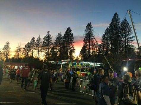 Fair goers enjoy games as the sun sets on Paradise. Photo credit: Melissa Joseph