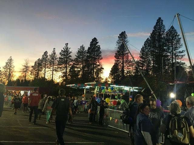 Fair goers enjoy games as the sun sets on Paradise. Photo credit: Melissa Joseph