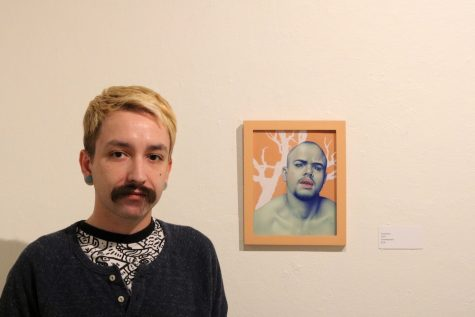 "Ryan standing next to his favorite piece ""Escalation."" Photo credit: Hana Beaty"