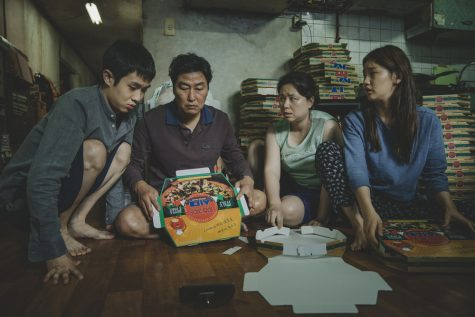"Left to right: Choi Woo-shik, Song Kang-ho, Jang Hye-jin and Park So-dam star as the impoverished Kim family in ""Parasite.""  Courtesy of NEON and CJ Entertainment."