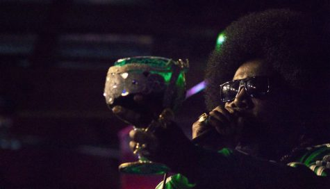 Afroman holds his cup as her performs
