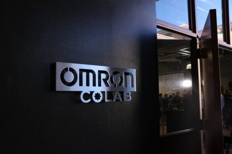 "A sign that reads ""OMRON COLAB: This classroom & Laboratory made possible through the generous support of Omron Corporation. Dedicated February 10, 2020 California State University, Chico."""