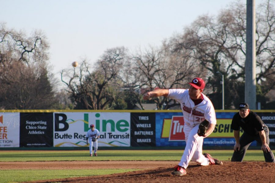 Chico State pitcher follows through his windup facing Fresno Pacific.