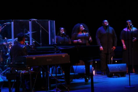Damien Sneed performing with a choir