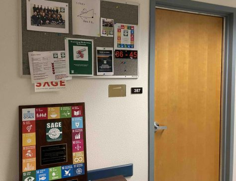 Curtis DeBerg's office door in Tehama Hall is left blank next to SAGE Global memorabilia. A plaque in honor of Sierra Nevada Brewing Company founder Ken Grossman is visible. It reads