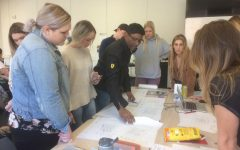 Rouben Mohiuddin instructs a circle of Chico State Architecture students in class. Photo by Emily Neria