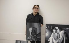 William Bays poses with his artwork.