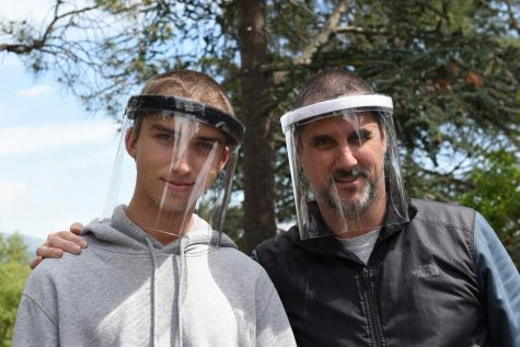 Griffin Wooldridge and Mike Wooldridge wearing their Open Source Shield face shields. Photo by Linda Wooldridge