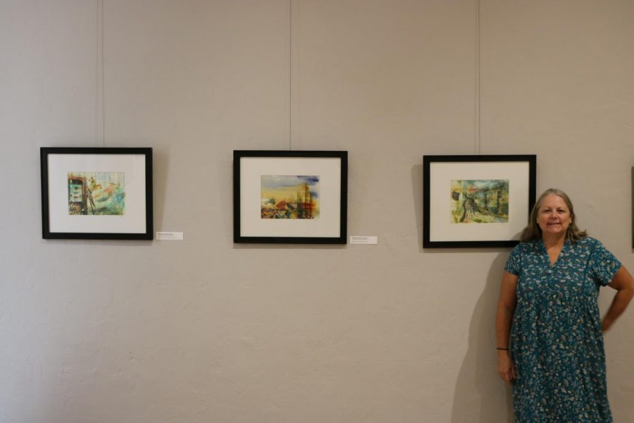 Kandis Horton-Jorth poses alongside her three pieces that will be available to view during the exhibit