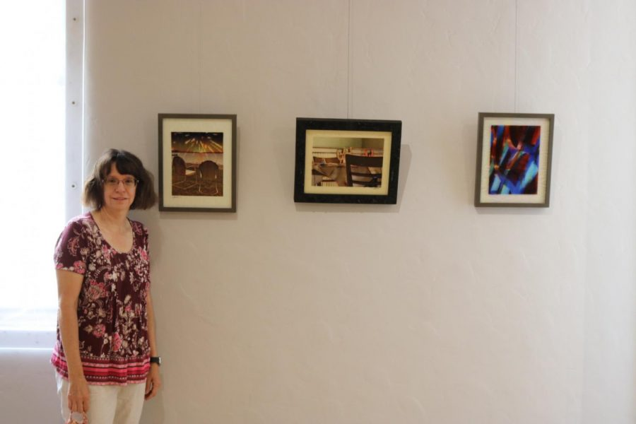 Penni Baxter stands with her work in the exhibit