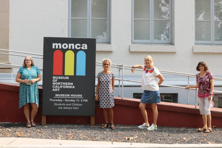 Three of the artists featured in the exhibit pose with the Monca's executive director, Pat Macias. [pictured left to right: Kandis Horton-Jorth, Pat Macias, Reta Rickmers, Penni Baxter.]