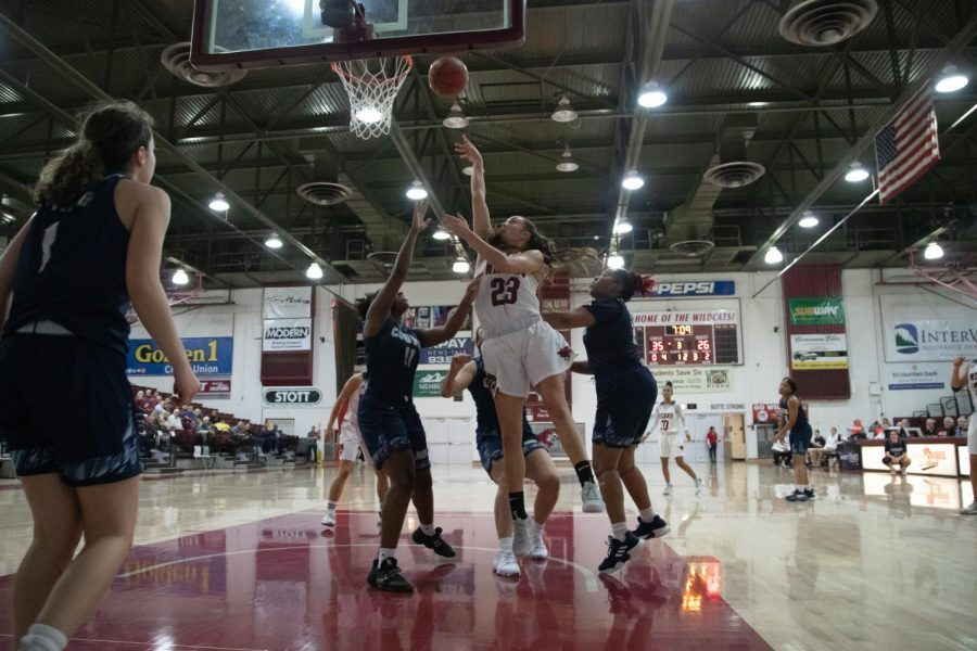 #23 Haley Ison goes up for a bucket in a basketball game at Chico State (Ryan McCasland/Chico State Sports Information)
