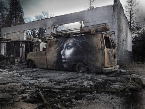 "A mural titled ""Unexpected Hope"" resides on the side of the burned van in Paradise."