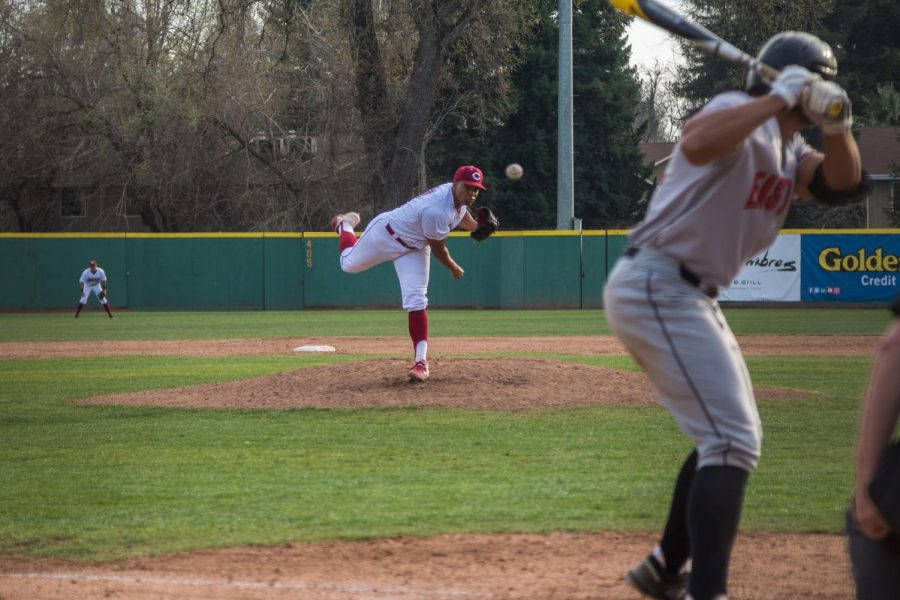 Chico State pitcher Kristian Scott throws a pitch during a game.
