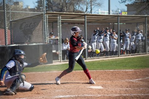 #20 Kristin Worley takes a swing in a softball game at Chico State. (Ryan McCasland/Chico State Sports Information)
