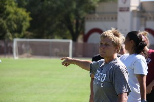 Shelby Keck Chico State women's coach Kim Sutton directs the players to move the ball down field during practice at the soccer stadium Wednesday.