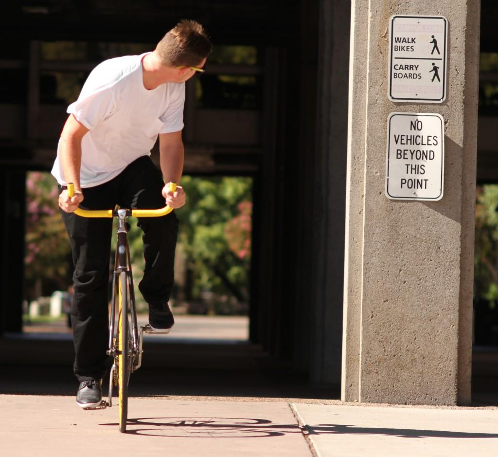 Riley Mundia Dustin Stene, a 23-year-old recreation major, rides his bike home through campus.