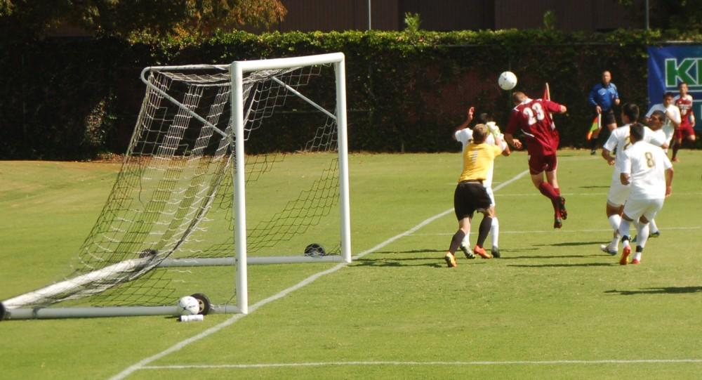 Dan Reidel Sophomore forward Matt Hurlow takes a shot on a corner kick against the Broncos defense during the mens soccer game against Cal Poly Pomona on Sunday. This shot was wide of the goal.
