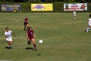 Carter Caldwell Torri Sims sprints back to keep the ball from heading towards the Wildcats' goal.