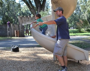 Photograph by Lindsay Pincus Cyrus Lemmon helps his son, Cyrus Lemmon Jr., climb up the slide at the local playground Caper Acres.