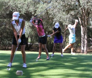 File photo by Riley Mundia Chico State women's golfers Abbey McGrew, Dani O'Keefe, Sydney Zink and Sarah McComish take some practice swings on the tee box.