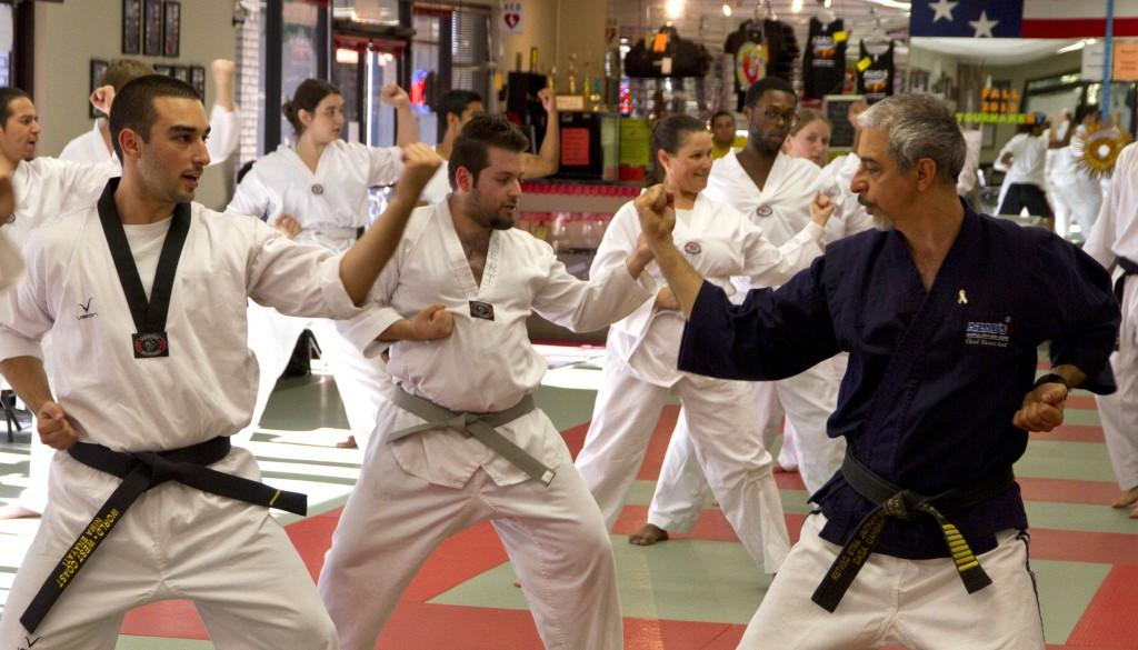 Photograph by Shelby Keck Grandmaster Farshad Azad leads students in a mixed martial arts course at his gym. Azad also teaches classes at Chico State.