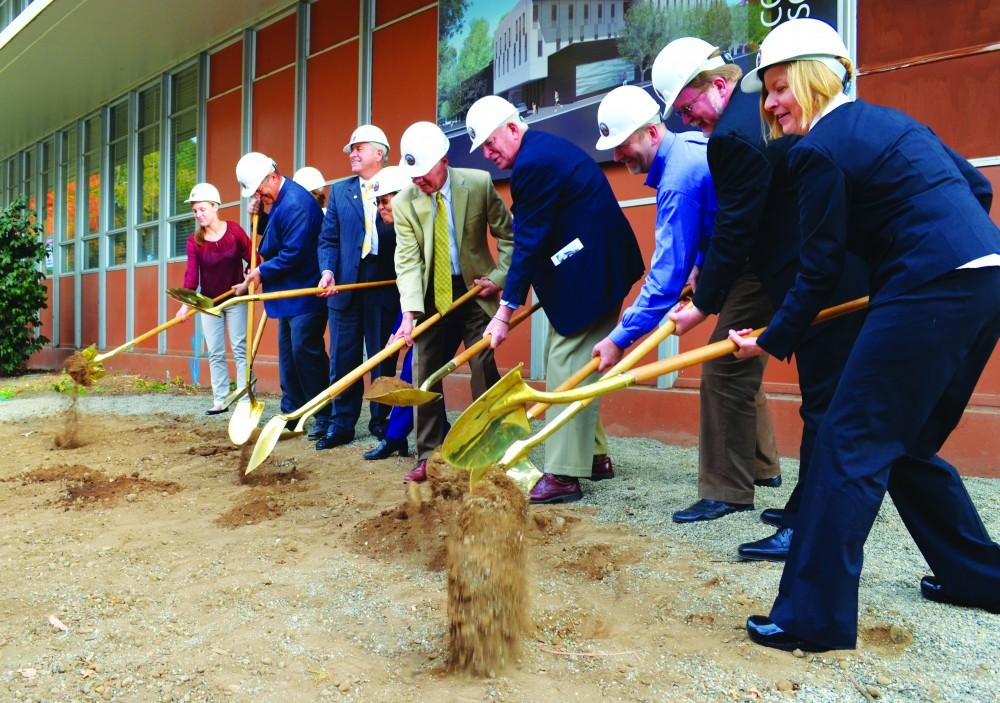 Photo Credit: Dan Reidel  Chico State administrators, along with A.S. President Taylor Herren, State Sen. Jim Nielsen and architect Bryan Shiles break ground for the new Arts and Humanities Building, scheduled to be completed in early 2016.