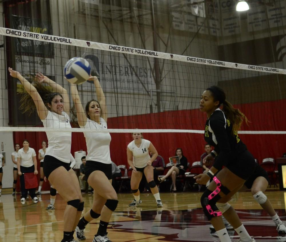 Photograph by Dan Reidel Chico State's volleyball team swept rival Humboldt State in three sets on Friday, Nov. 22, 2013. Freshman middle hitter Natalie Nordahl, left, and junior middle hitter Kristyn Casalino block a shot by the Lumberjacks.Photo credit: Dan Reidel.