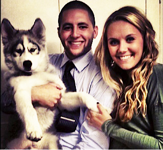 Photograph courtesy of Kalli Smith Phil Bartlett and Kalli Smith hold their husky, Jax. The two got the pet after more than five years together.