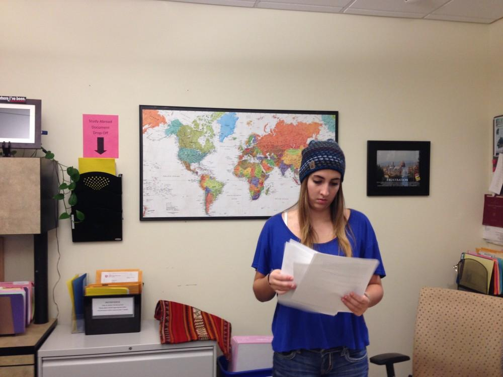 Photograph by Dan Reidel  Mychal Garcia, a senior Spanish and Latin American studies double major, processes paperwork in the International Student Services office. The office handles international student advising and admissions along with the study abroad program.