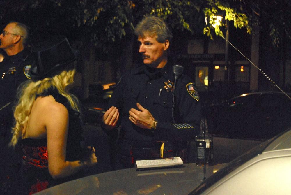 Lt. George Laver tells a minor what kind of charges she could face for drinking on Halloween this year.Photo credit: Kasey Judge.