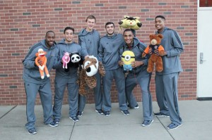 Photograph by Lindsay Pincus Members of the Chico State men's basketball team pose with stuffed animals.