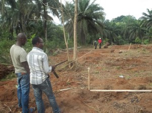 Photograph courtesy of James Umekwe Workers measure the land during the early stages of constructon of Upon This Rock Medical Center last year. The Kristina Chesterman Memorial Clinic, which will be built in Umuahia, Nigeria, will be a sister clinic to the center.