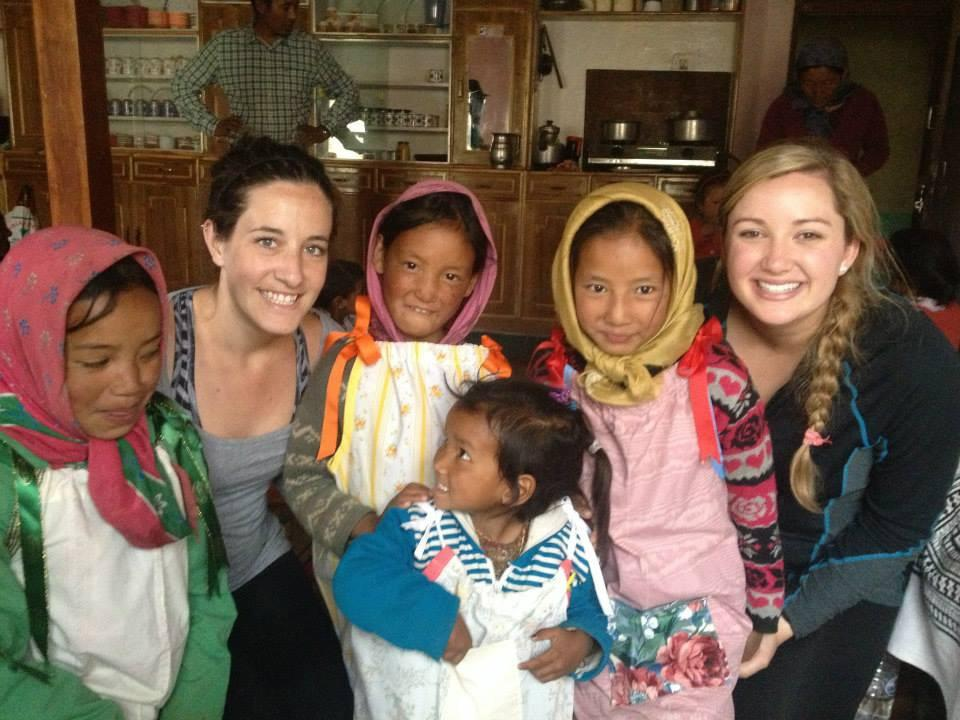 Photograph courtesy of Noelle Jahn Nursing majors Noelle Jahn and Faren Sanford smile with girls from the Spiti Valley in the Indian Himalayas.