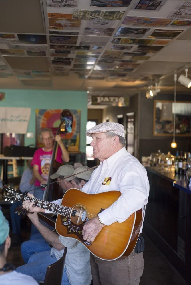 Eddy Eddy B. Baker, of Eddy B. and Pure Country Plus, soulfully croons to audiences at Cafe Flo on Saturday.Photo credit: Matthew Vacca