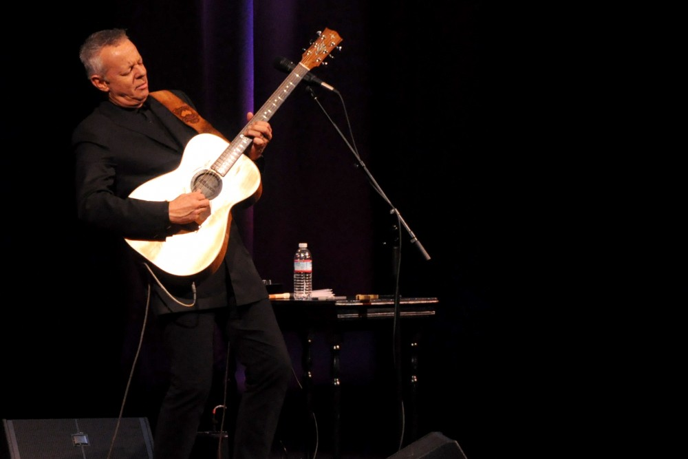 Tommy Emmanuel rocks out on the guitar for audiences Thursday night at Laxson Auditorium.Photo credit: Annie Paige