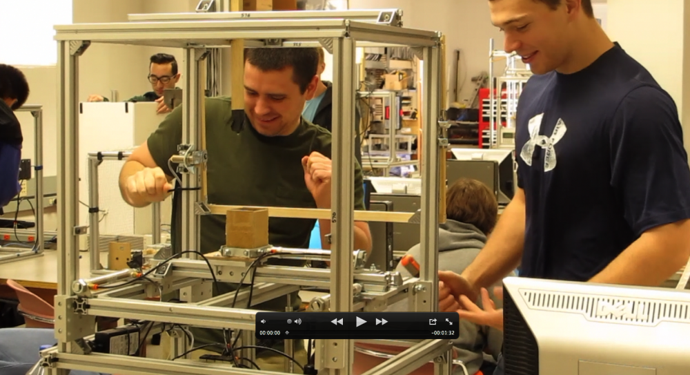 Mechanical engineering majors Trevor Borelli and Forrest Clune are working on an electric machine in their engineering class. The machine they named as