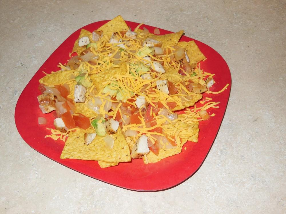 Grilled chicken nachos make a great dish to bring to parties, or just eat at home.Photo credit: Christina Saschin