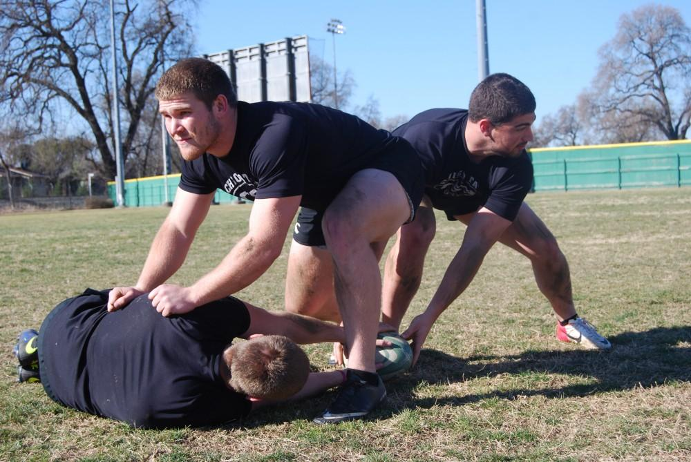 JW Davis, a junior agricultural business major,  Brandon Johnson, a junior exercise physiology major and Ian McLens, a junior criminal justice major, take their skills from football to the rugby pitch.Photo credit: Kasey Judge