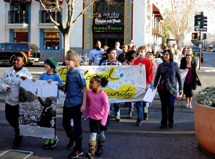 Crowd marches in Martin Luther King Jr.'s memory