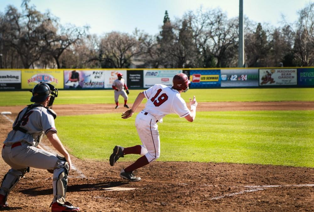 Number 19, Eric Angerer, senior first baseman, leaves home after a hit.Photo credit: Emily Teague