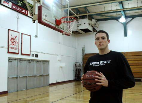 Nate Appel, senior men's basketball player, uses a ball with hero Larry Bird's name on it. Photo credit: Quinn Western.
